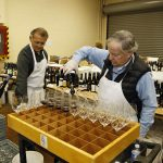 Volunteers preparing wine for judging